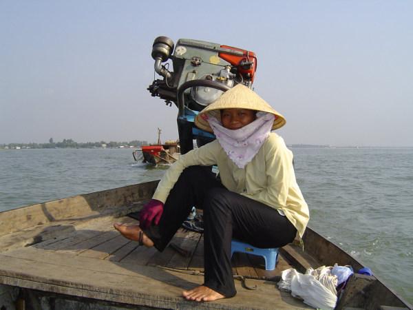 Bootsführerin im Mekong Delta